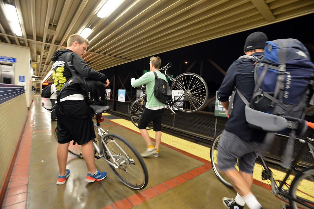Description of . BART patrons carrying bicycles await a train bound for San Francisco at the MacArthur station in Oakland, Calif., on Thursday, Aug. 29, 2013. (Kristopher Skinner/Bay Area News Group)