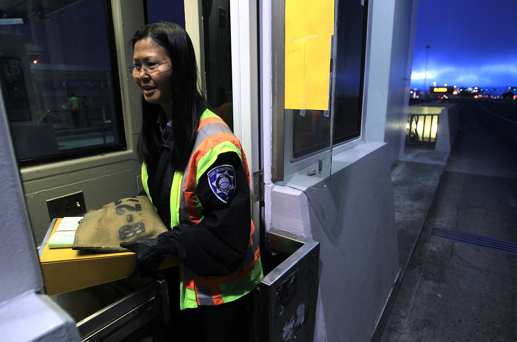 Description of . Toll taker Annabelle Tan, of Hayward, leaves her station after the last car crossed the San Francisco-Oakland Bay Bridge in Oakland, Calif., on Wednesday, Aug. 28, 2013. The old eastern span was shut down permanently at 8 p.m. tonight, and the new span will open to traffic at 5 a.m. on Tuesday, Sept. 3.  Construction of the largest self-anchored suspension bridge in the world began in 2002. (Jane Tyska/Bay Area News Group)