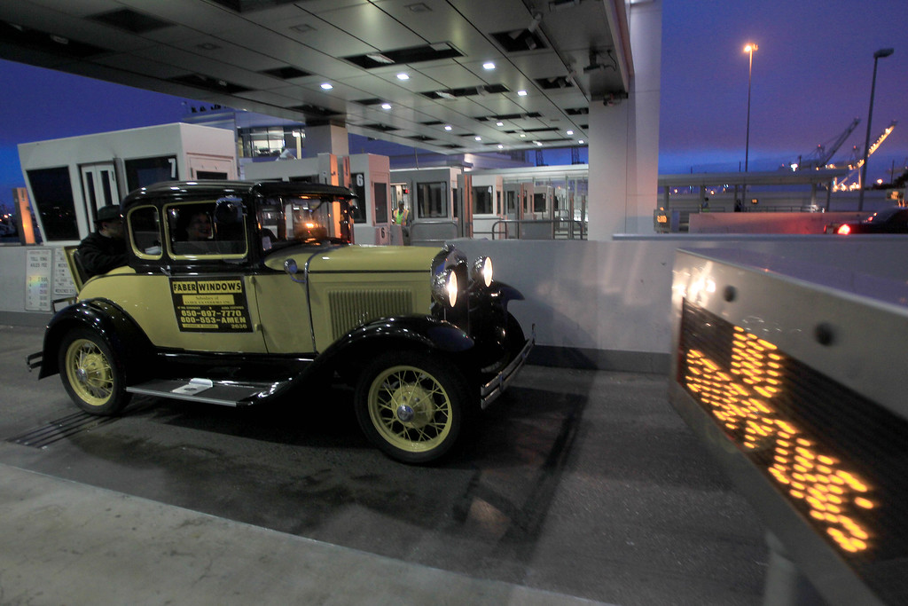 Description of . Bob Faber, of Richmond, drives his 1930 Model A Ford through the toll plaza as it became the last car ever to cross the the old eastern span of the Bay Bridge in Oakland, Calif., on Wednesday, Aug. 28, 2013. The old span was shut down permanently at 8 p.m. tonight, and the new span is scheduled to open to traffic at 5 a.m. on Tuesday, Sept. 3.  Construction of the largest self-anchored suspension bridge in the world began in 2002. (Jane Tyska/Bay Area News Group)