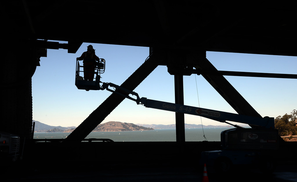 Description of . With the five-day bridge closure in place, maintenance crews work Friday morning, Aug. 30, 2013 on the lower deck of the original Bay Bridge's western span in San Francisco, Calif. (Karl Mondon/Bay Area News Group)