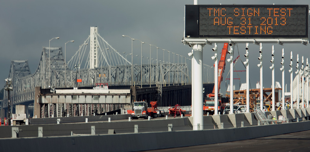 Description of . An electronic message sign shows the wrong date, Sunday, Sept. 1, 2013, in Oakland, Calif., as work continued to prepare the new eastern span of the Bay Bridge for its scheduled opening on Tuesday at 5 a.m. (D. Ross Cameron/Bay Area News Group)
