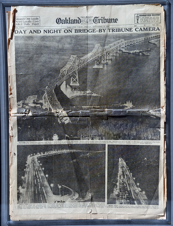 Description of . A 76-year-old copy of the Oakland Tribune celebrates the opening of the original Bay Bridge on Nov. 12, 1936, with Clyde Sunderman aerial photographs showing the first vehicles to cross the brand new span near Yerba Buena Island. (Bay Area News Group Archives)