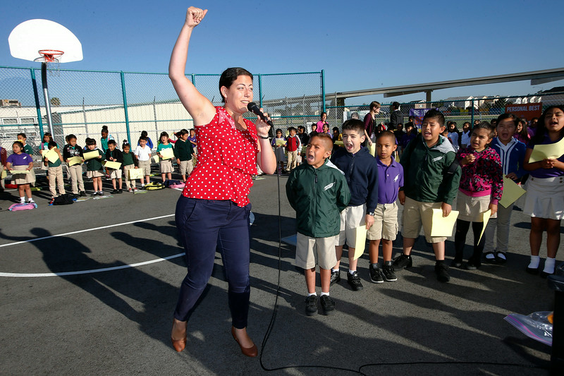 Cristina Callagy, assistant principal, gets the student body fired up during the morning launch session to get the day started at the Rocketship Spark Academy in San Jose, Calif. on Tuesday, May 27, 2014.  The morning launch is meant to build the school's culture, have fun, and get the students focused on the upcoming school day.  (Gary Reyes/Bay Area News Group)