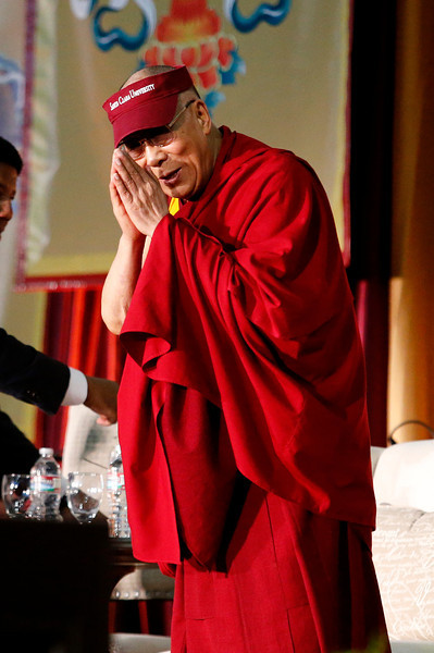 Tibetan spiritual leader the Dalai Lama gestures to the crowd following his speech on business, ethics and compassion at the Leavey Event Center at Santa Clara University in Santa Clara, Calif. on Monday, Feb. 24, 2014.  (Gary Reyes/Bay Area News Group)