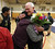 Albany High School wrestling coach Kermit Bankson, right, gets a hug from alumni Daniel Singh, 23, of Berkeley, after their match against Tennyson High School in Albany, Calif. on Friday, Jan. 17, 2013. Bankson is retiring after coaching the Cougars for 43 years, and this was his last match. (Jane Tyska/Staff)