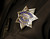 The badge of San Jose Police Officer Mark Minten after he graduated form the San Jose Police Academy in San Jose, Calif. on Friday, March 15, 2013.   (LiPo Ching/Staff)
