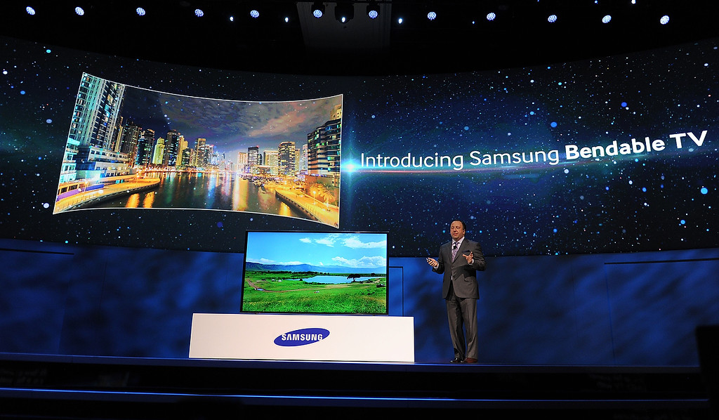Description of . Samsung Electronics America Executive Vice President Joe Stinziano introduces Samsung\'s new bendable television screen at the Samsung press event at the Mandalay Bay Convention Center for the 2014 International CES on January 6, 2014 in Las Vegas, Nevada. (ROBYN BECK/AFP/Getty Images)