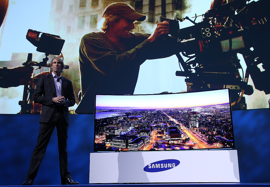 Description of . Motion picture director Michael Bay pauses as he speaks during a Samsung Electronics press event at the Mandalay Bay Convention Center for the 2014 International CES on January 6, 2014 in Las Vegas, Nevada. (Justin Sullivan/Getty Images)