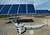 A QBotix robot moves along a rail system to each of the solar panels to orientate it toward the sun at a solar panel array located at the Santa Rita Jail in Dublin, Calif., on Wednesday, March 13, 2013. The Menlo Park based start-up makes a robotic tracking system making solar power cheaper. One QBotix robot can orientate up to 1,200 solar panels, replacing the need for expensive dual-axis tracking systems that require a lot of steel. (Doug Duran/Staff)