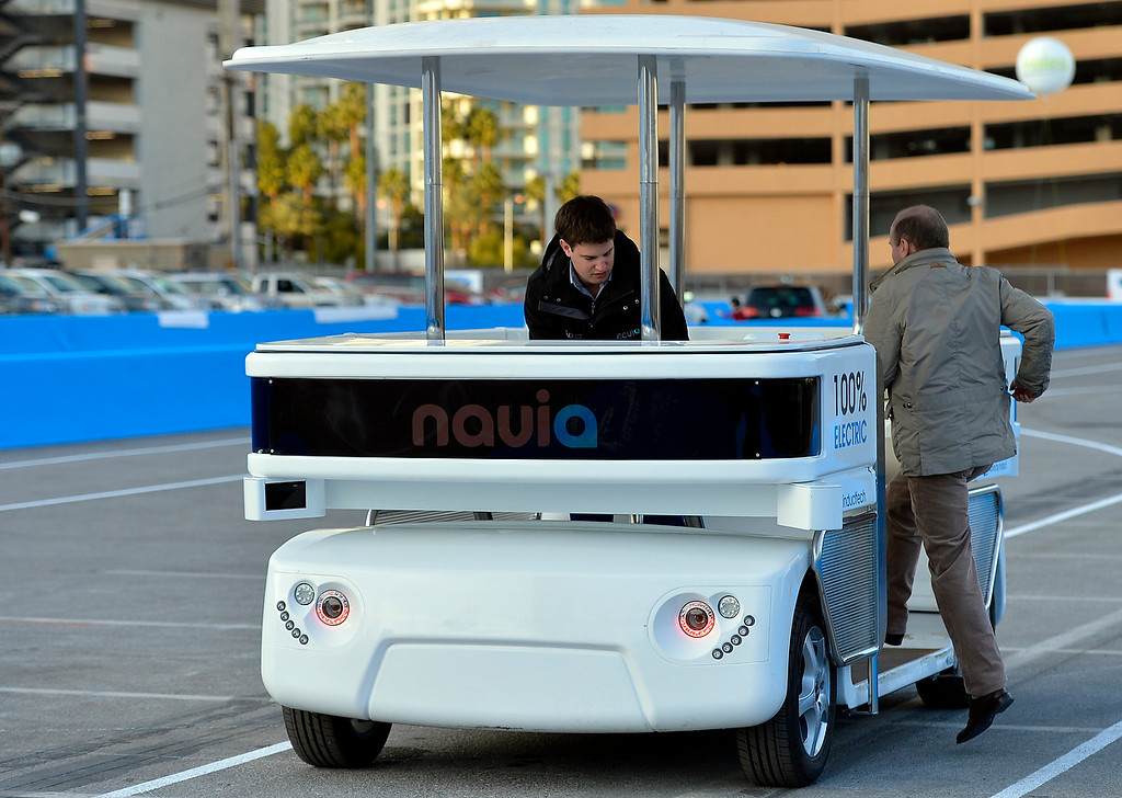 Description of . Induct demonstrates their new Navia driverless shuttle at the International Consumer Electronics Show Monday, Jan. 6, 2014, in Las Vegas. (AP Photo/Jack Dempsey)