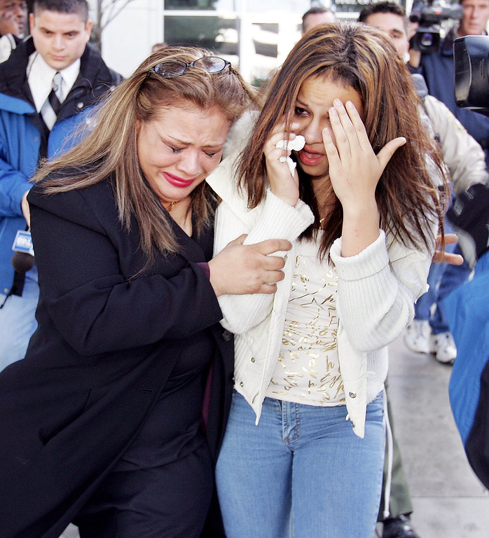 Description of . Anna Ayala's sister, Mary Ayala, left, and Anna Ayala's daughter, Genesis Reyes, right, leave a Santa Clara County Superior Court in a San Jose, Calif., Wednesday, Jan. 18, 2006 after Ayala and her husband Jaime Plascencia were sentenced. Plascencia and Ayala, who cooked up a scheme last March to plant a severed finger in a bowl of Wendy's chili to extort money from the fast food chain, were sentenced to lengthy prison terms.   (AP Photo/Paul Sakuma)