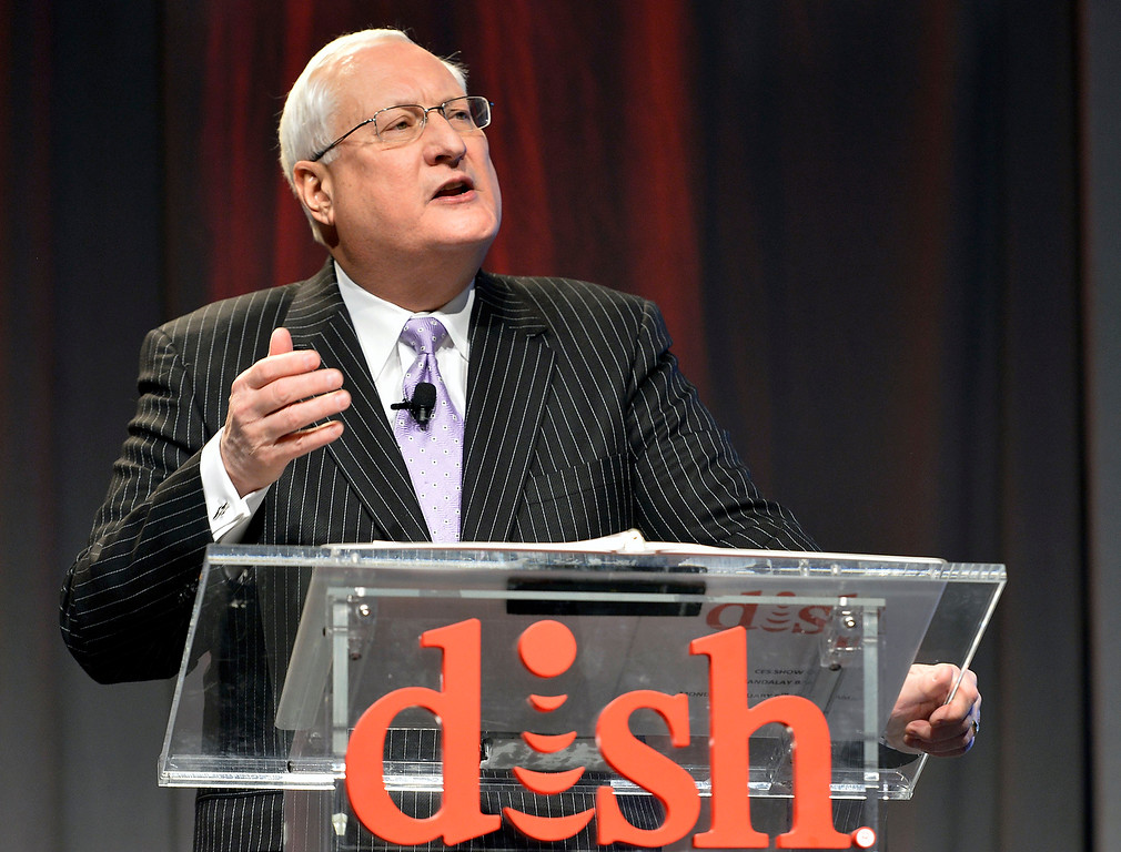 Description of . Dish president and CEO Joe Clayton talks to the media during the Dish news conference at the International Consumer Electronics Show Monday, Jan. 6, 2014, in Las Vegas. (AP Photo/Jack Dempsey)
