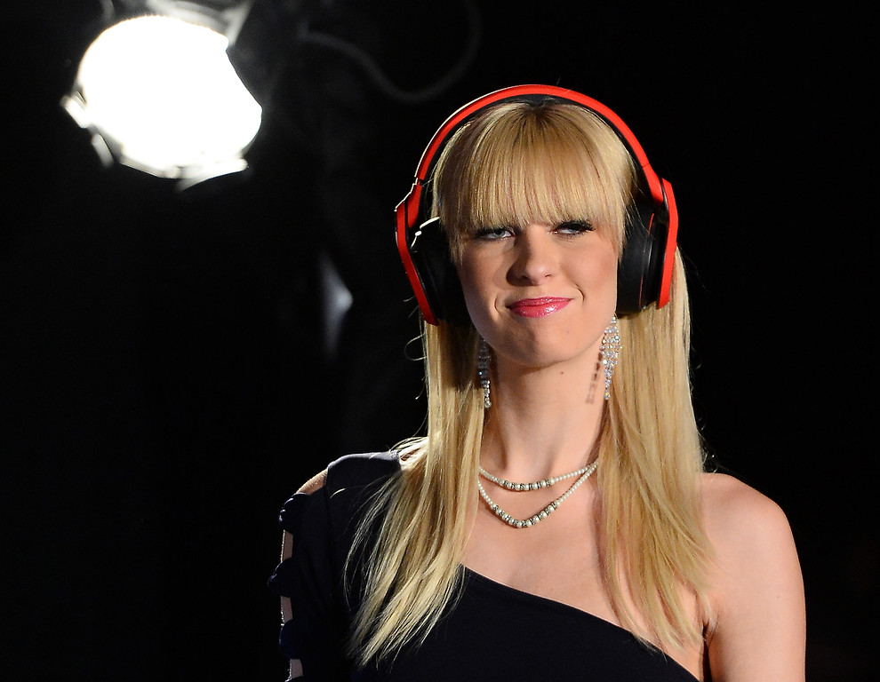 Description of . A model wears Monster Octagon headphones after it was announced they were the official headphones of the UFC at a Monster Inc. press event at the Mandalay Bay Convention Center for the 2014 International CES on January 6, 2014 in Las Vegas, Nevada. (Ethan Miller/Getty Images)