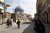 In this March 8, 2013 photo, pedestrians walk down Rashid Street in Baghdad, Iraq. In Baghdad, life goes on much as it has since the Ottoman sultan ruled these parts. Yet the legacy of a war that began a decade ago remains very much a part of life here too. (AP Photo/Hadi Mizban)