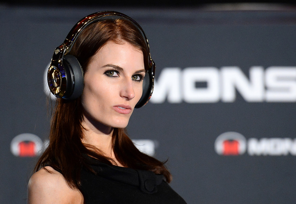 Description of . A model wears Monster 24k headphones at a press event for Monster Inc. at the Mandalay Bay Convention Center for the 2014 International CES on January 6, 2014 in Las Vegas, Nevada. (Ethan Miller/Getty Images)