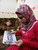 Samar Hassan, 16, looks at a photo of the family car after they were shot at in 2005, during an interview with Reuters in Mosul, 390 km (240 miles) north of Baghdad, March 6, 2013. Samar, a Turkman from the city of Tel Afar, is one of thousands of Iraqis who have relatives that were killed by U.S. forces, since the U.S.-led invasion of Iraq in 2003. Samar said she was sitting in the back seat of the car with her brother and three sisters on their way back from hospital on January 18, 2005 when a group of U.S. soldiers shot at them, killing her parents on the scene and seriously wounding her brother, Rakan. Many Iraqis often accuse U.S. forces of being too quick to open fire, often killing innocent civilians.  REUTERS/Thaier al-Sudan