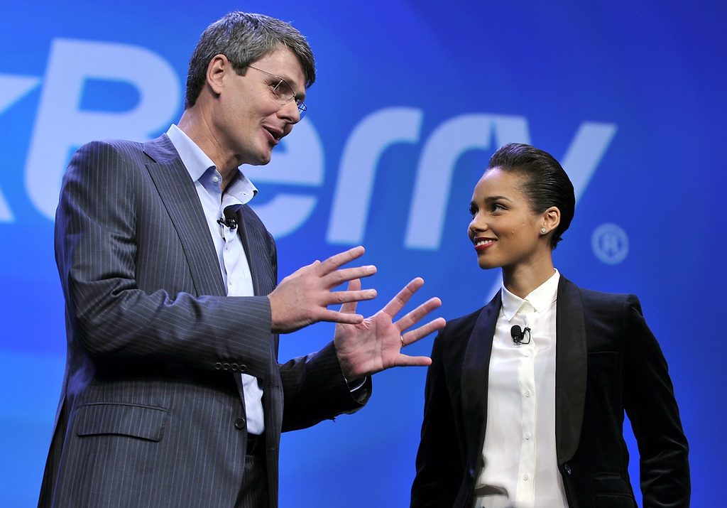 Description of . Blackberry, formerly Research in Motion CEO Thorsten Heins, and singer Alicia Keys officially unveil the BlackBerry 10 mobile platform as well as two new devices January 30, 2013 at the New York City Launch at Pier 36. (TIMOTHY A. CLARY/AFP/Getty Images)