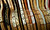 An assortment of wooden tennis racquets wait in the sporting goods section of the annual White Elephant Sale, at the Oakland Museum Women's Board 96,000-square-foot warehouse in Oakland, Calif., Tuesday, Jan. 15, 2013. (D. Ross Cameron/Staff)
