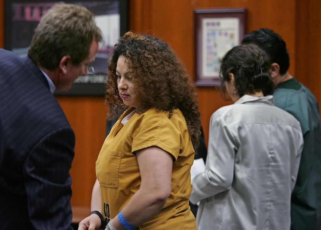 Description of . Anna Ayala, center left, talks with her attorney, Rick Ehler, far left, as her husband, Jamie Placencia, far right, talks with an interpreter, in a San Jose, Calif. courtroom, Friday, Sept. 9, 2005 before they pleaded guilty of all charges related to planting a human finger in a bowl of Wendy's chili. Ayala and Placencia both pleaded guilty on Friday to conspire to file a false claim and attempting grand theft from the fast food restaurant chain. (AP Photo/Paul Sakuma)