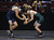 De La Salle's Aaron Pease, left, wrestles Clovis East's Nick Callender in a 170-pound match during the California Interscholastic Federation wrestling championships in Bakersfield, Calif., on Friday, March 1, 2013. Pease would go on to win the match. (Anda Chu/Staff)