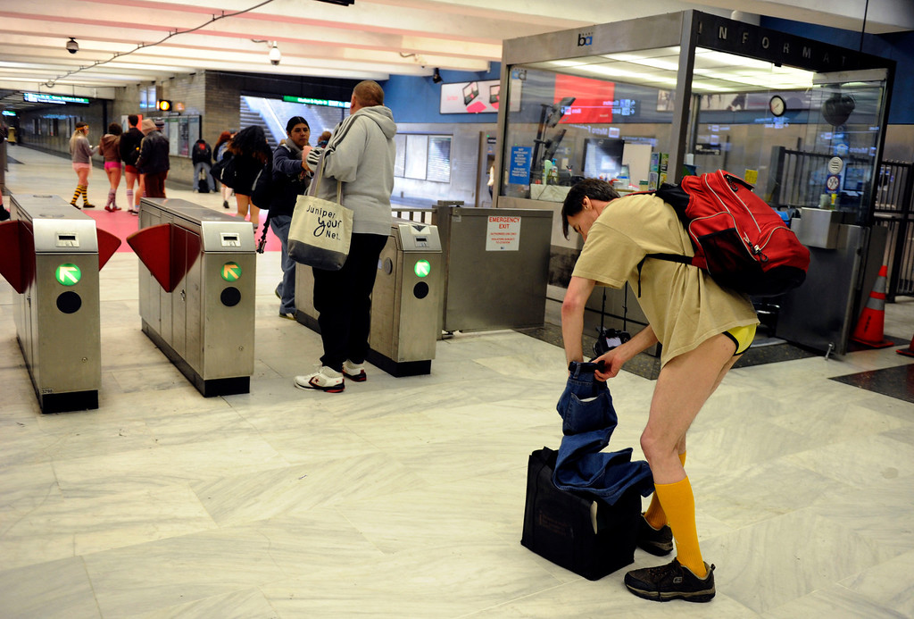 Description of . The problem with no pants is no pockets as Chuck Newell of San Francisco digs through his jeans pockets in search of his BART ticket to exit at the Civic Center station during the