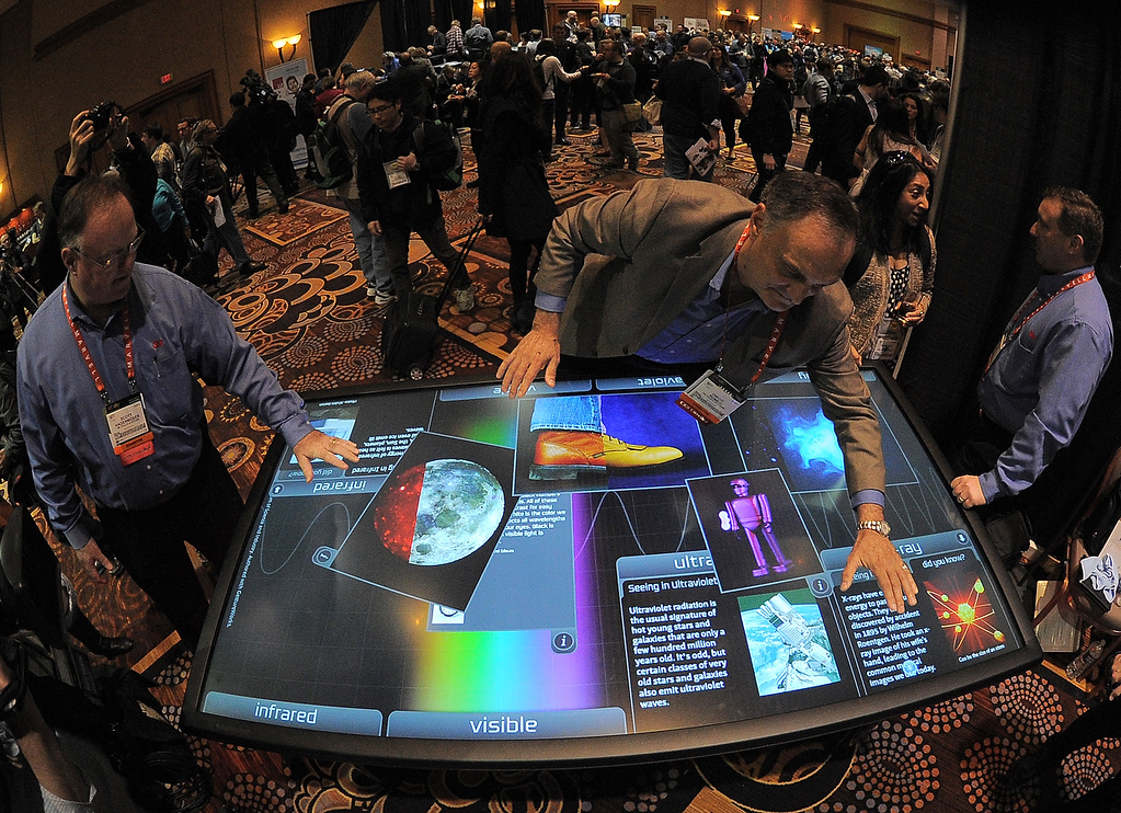 Description of . Diego Romeu of 3M Touch Systems shows 84 inch touch table during the opening event \'\'CES Unveiled\'\'  during the  International Consumer Electronics Show (CES) in Mandalay Bay Hotel resort on January 06, 2013 in Las Vegas, Nevada. (JOE KLAMAR/AFP/Getty Images)