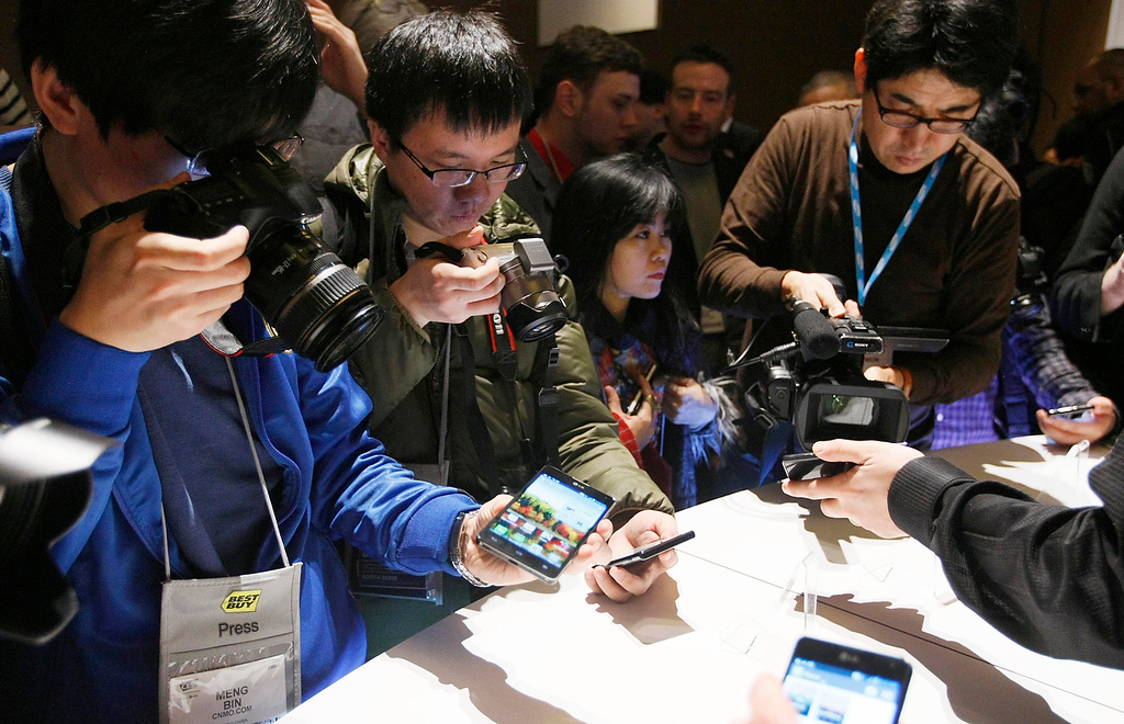 Description of . Journalists shoot pictures and videos of new LG smartphones at the Consumer Electronics Show (CES) in Las Vegas January 7, 2013 after their news conference. (REUTERS/Rick Wilking)