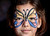 Seven-year-old Zoe Nguyen shows off her butterfly face paint at Hakone Estate and Gardens Lunar New Year of the Snake festival with a