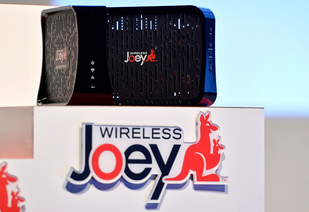 Description of . Dish shows off the new wireless Joey during the Dish news conference at the 2014 International Consumer Electronics Show Monday, Jan. 6, 2014, in Las Vegas. (AP Photo/Jack Dempsey)