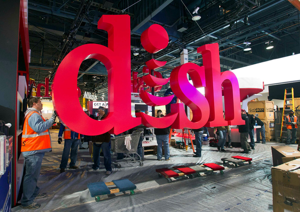 Description of . Workers build a booth for Dish, a satellite TV provider, as they prepare for the International CES show at the Las Vegas Convention Center in Las Vegas, Nev., on Jan. 4, 2013. The annual CES electronics technology trade show is expected to cover 1.85 million square feet of exhibition space and attract 150,000 attendees. The show begins Jan. 8. (REUTERS/Steve Marcus)