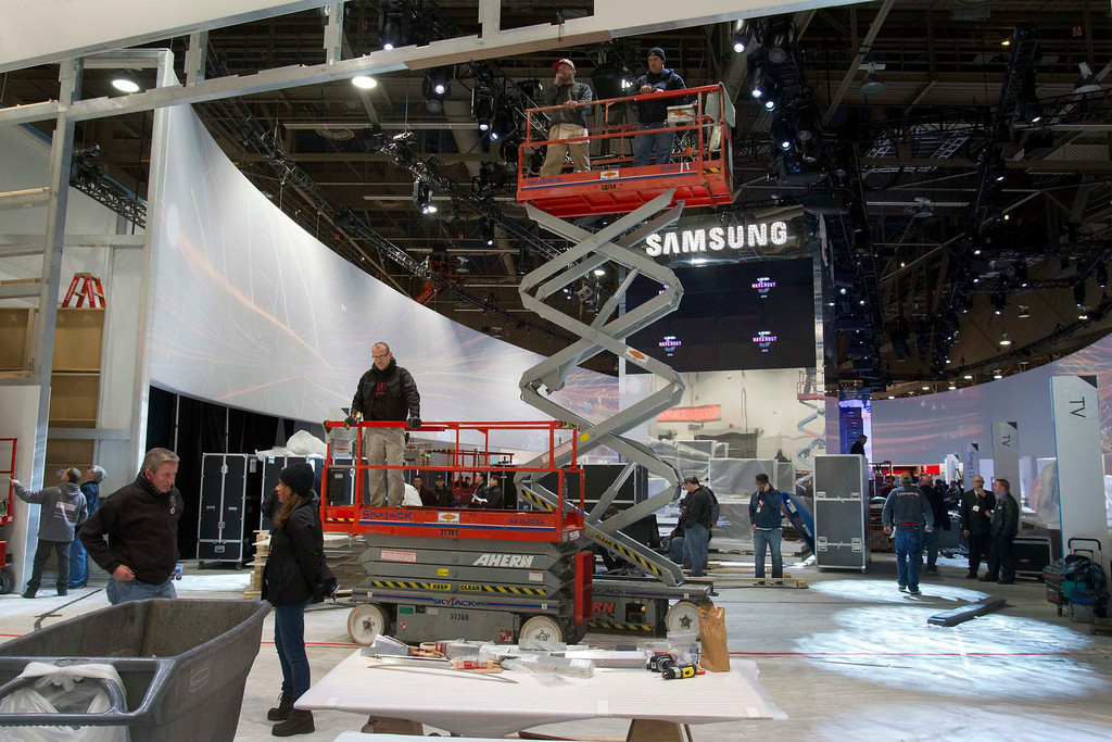 Description of . Workers prepare the Samsung booth for the International CES at the Las Vegas Convention Center in Las Vegas, Nev., on Jan. 5, 2013. (REUTERS/Steve Marcus)
