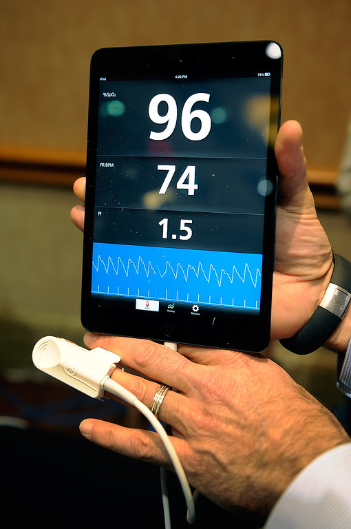 Description of . An iSpO2 pulse oximeter is on display at a press event at the Mandalay Bay Convention Center for the 2013 International CES on January 6, 2013 in Las Vegas, Nevada. The USD 249 personal health monitor attaches to the user\'s mobile device that can record, save and transmit vital statistics. (Photo by David Becker/Getty Images)