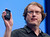 Mike Bell, vice president of Intel's mobile and communications group, holds a smart phone powered by an Intel processor at an Intel news conference during the Consumer Electronics Show (CES) in Las Vegas January 7, 2013. Intel announced improvements to its processors including one with