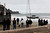 Spectators watch as the 82-foot long sailboat named the Darling rocks in the surf after running aground off Linda Mar Beach in Pacifica, Calif., Monday morning March 4, 2013. (Karl Mondon Photo)