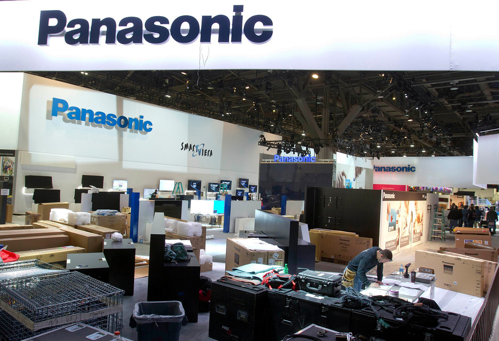 Description of . Workers prepare the Panasonic booth for the International CES show at the Las Vegas Convention Center in Las Vegas, Nev., on Jan. 4, 2013. The annual CES electronics technology trade show is expected to cover 1.85 million square feet of exhibition space and attract 150,000 attendees. The show begins January 8. (REUTERS/Steve Marcus)