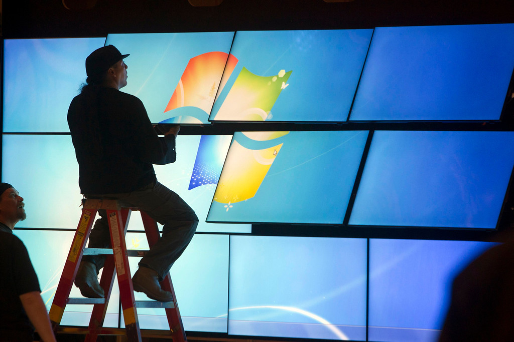 Description of . A technician works on a video wall for a Samsung booth in the lobby of the Las Vegas Convention Center as exhibitors prepare for the International CES in Las Vegas, Nev., on  Jan. 5, 2013. (REUTERS/Steve Marcus)