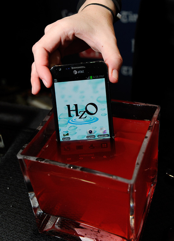 Description of . An iPhone using HzO Waterblock technology is displayed in a bowl of water during a press event at the Mandalay Bay Convention Center for the 2013 International CES on January 6, 2013 in Las Vegas, Nevada. (Photo by David Becker/Getty Images)