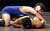 South San Francisco's Arthur Georgiyev, top, wrestles Servite's Johnny Beltran in a 182-pound second round match during the California Interscholastic Federation wrestling championships in Bakersfield, Calif., on Friday, March 1, 2013. Beltran would go on to win the match and advance to the third round. (Anda Chu/Staff)