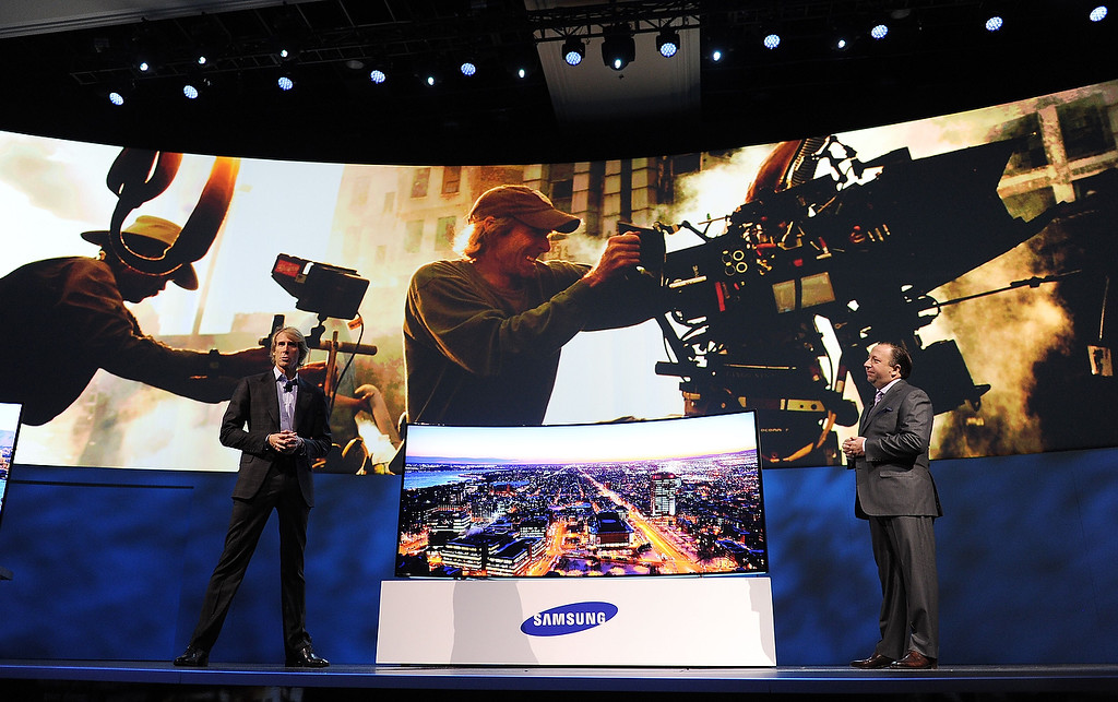 Description of . Samsung Electronics America Executive Vice President Joe Stinziano (R) and movie director Michael Bay (L) speak at the Samsung press event at the Mandalay Bay Convention Center for the 2014 International CES on January 6, 2014 in Las Vegas, Nevada. (ROBYN BECK/AFP/Getty Images)