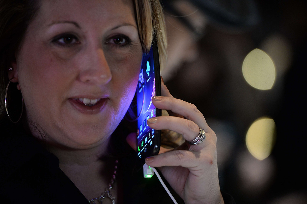 Description of . LG representative Amy Sanchez holds LG\'s new G Flex curved screen smartphone during the LG press conference at the Mandalay Bay Convention Center for the 2014 International CES on January 6, 2014 in Las Vegas, Nevada. (ROBYN BECK/AFP/Getty Images)