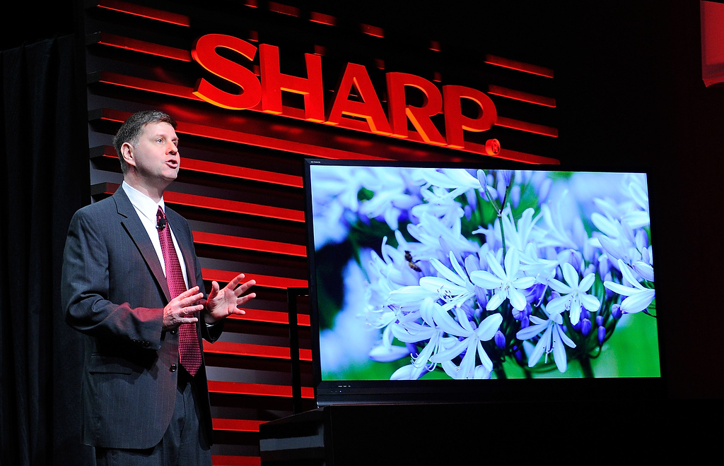 Description of . Sharp Electronics Vice President of Strategic Products Marketing Jim Sanduski unveils the Sharp ICC Purios 4K ultra HD television at a press event at the Mandalay Bay Convention Center for the 2013 International CES on January 7, 2013 in Las Vegas, Nevada. (Photo by David Becker/Getty Images)