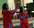 "Harlem Globetrotters' Slick Willie Shaw and rookie teammate and Oakland native Tammy ""T-Time"" Brawner visit Laurel Elementary School in Oakland, Calif., on Wednesday, Jan. 16, 2013. (Anda Chu/Staff)"