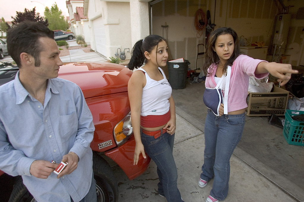 Description of . Genesis Reyes, 13, right, describes how police detained her and allegedly hurt her arm as they executed a search warrant at the Las Vegas home of her mother, Anna Ayala, Thursday, April 7, 2005. Looking on are family friend Ken Bono, 24, who lives at the residence, and cousin Priscilla Chavarin, 16. Ayala, who claims she bit into a human finger while eating chili at a Wendy's restaurant, has a history of filing lawsuits, including a claim against another fast-food restaurant. (AP Photo/Las Vegas Review-Journal, K.M. Cannon)