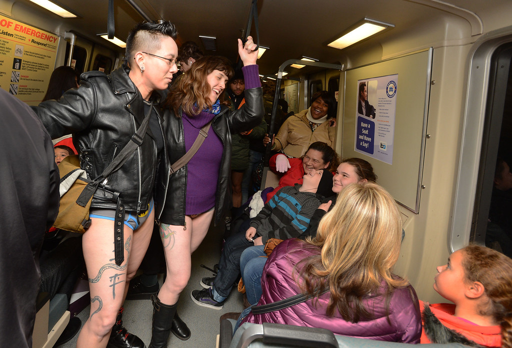 ". Some diverted their eyes, others were glued to their smart phones but some strangers struck up conversation with strangers with barely covered lower halves during the ""12th Annual No Pants Subway Ride\"" in San Francisco, Calif. on Sunday, Jan. 13, 2013.  (Susan Tripp Pollard/Staff)"