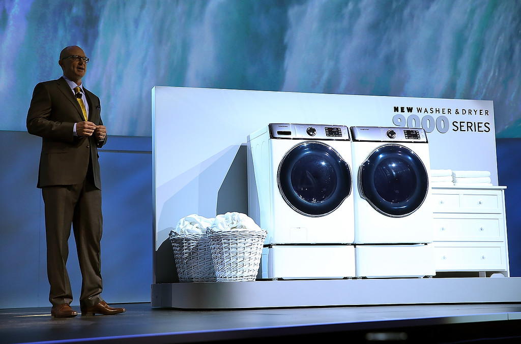 Description of . Samsung Electronics Senior Vice President Kevin Dexter announces the new Samsung 9000 series washer and dryer during a press event at the Mandalay Bay Convention Center for the 2014 International CES on January 6, 2014 in Las Vegas, Nevada. (Justin Sullivan/Getty Images)
