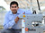 Wasiq Bokhari, of Half Moon Bay, the Founder and Chief Executive Officer of QBotix, has his photo taken next to one of the QBotix's robots that is installed on the solar panel array located at the Santa Rita Jail in Dublin, Calif., on Wednesday, March 13, 2013. The Menlo Park based start-up makes a robotic tracking system, that has a single robot moving throughout a solar installation orientating the panels toward the sun. One QBotix robot can orientate up to 1,200 solar panels. The robot is replacing the need for expensive dual-axis tracking systems that require a lot of steel. (Doug Duran/Staff)