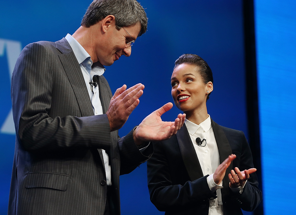 Description of . BlackBerry President and Chief Executive Officer Thorsten Heins (L) stands with new BlackBerry Global Creative Director Alicia Keys at the BlackBerry 10 launch event at Pier 36 in Manhattan on January 30, 2013 in New York City. (Photo by Mario Tama/Getty Images)