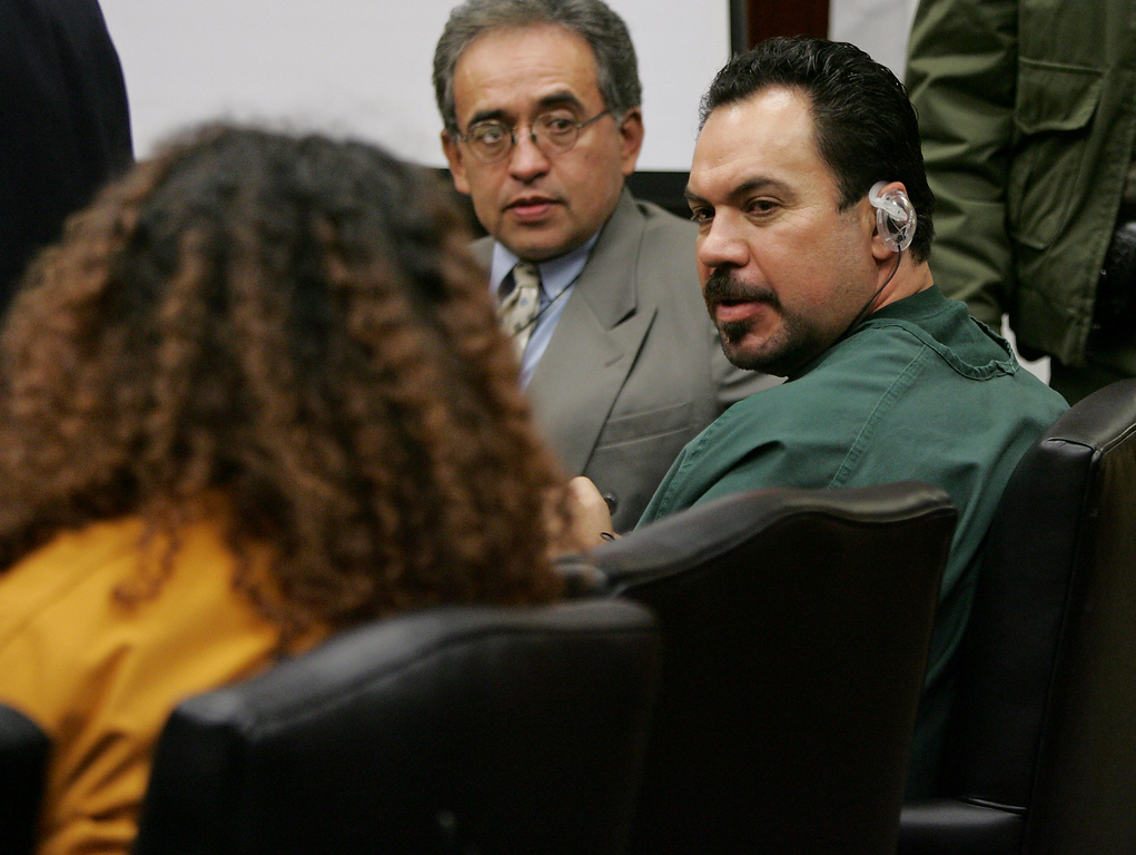 Description of . Anna Ayala, left, and her husband, Jaime Plascencia, right, exchange words after they were sentenced in a Santa Clara County Superior Court in a San Jose, Calif., courtroom, Wednesday, Jan. 18, 2006.  Ayala and Plascencia, who cooked up a scheme last March to plant a severed finger in a bowl of Wendy's chili to extort money from the fast food chain were sentenced to Wednesday. Ayala, 40, was sentenced to nine years and Plascencia was sentenced to more than 12 years. In center is an unidentified interpreter. (AP Photo/Paul Sakuma)