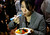 A Japanese reporter with TV Asahi tries out the HAPIfork at the opening press event of the Consumer Electronics Show (CES) in Las Vegas on Jan. 6, 2013. The fork, introduced today, keeps track of the number of fork servings you take, measures how fast you are eating and alerts the user with lights and vibration if you are eating too fast. (REUTERS/Rick Wilking)