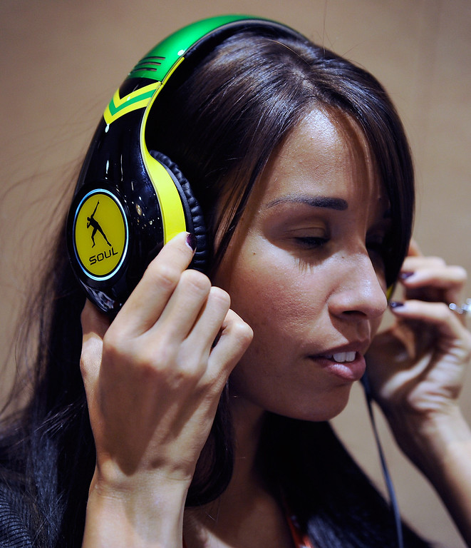 Description of . Shauna Cyr wears a pair of USD 299 Soul SL300 noise-cancelling headphones at a press event at the Mandalay Bay Convention Center for the 2013 International CES on January 6, 2013 in Las Vegas, Nevada. (Photo by David Becker/Getty Images)